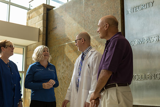 "Jill Clark, RN, with Flaget Memorial Hospital, Lisa Smith, RN, with Saint Joseph Hospital, Todd Linley, a volunteer with Saint Joseph Hospital, and Norris ""Chip"" Hollon, PharmD, a pharmacist with Saint Joseph Hospital"