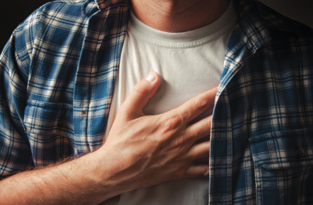 man-holding-chest-pain